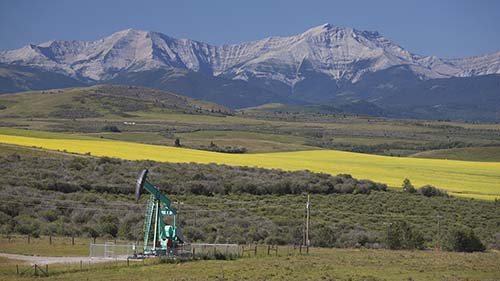 pumpjack with mountains